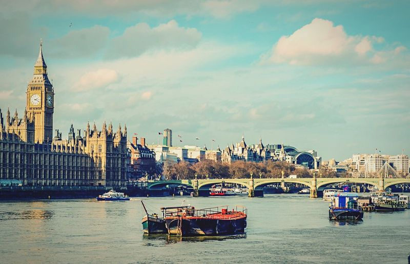 A classic London day with Big Ben, Westminster Bridge and the ever present River Thames. London Big Ben River Thames Westminster Bridge Boats Barges Parliament Building British Parliament House Of Commons Uk London Landmarks Britain Capital Westminster Westminster Palace Londres Britannia Thames