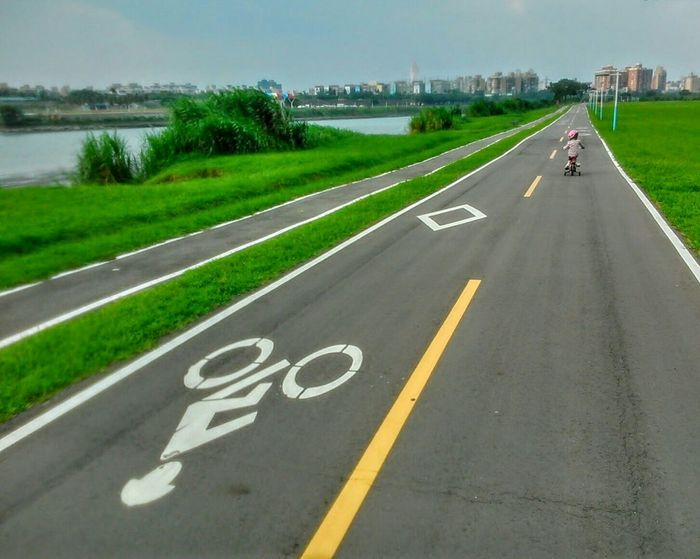 Bicycling On The Road Green Grass