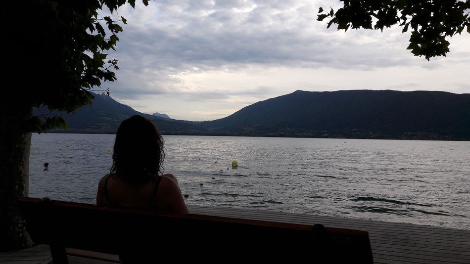 Woman Shade Water One Person Mountain Lake People Tree Outdoors Sky Nature End Of Day Moutain France 🇫🇷 Annecy Lake Beautiful Thoughts Thinking About Life Lonely Alone Only Women Reflection One Woman Only Light And Shadow Contrast
