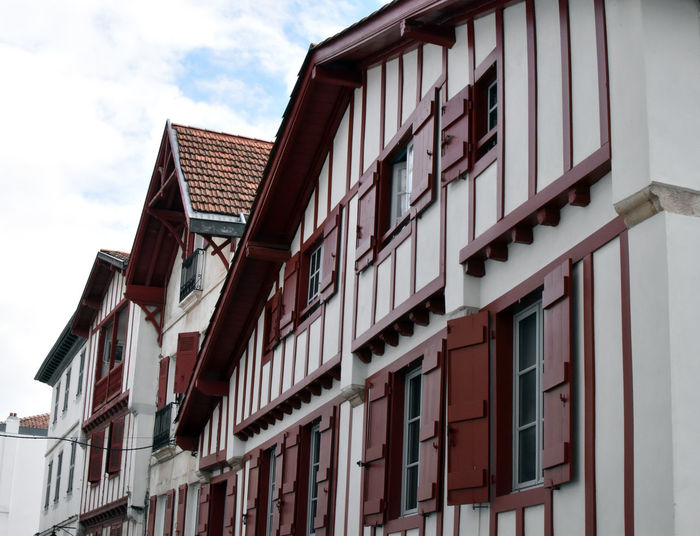 Low angle view of houses in town against sky
