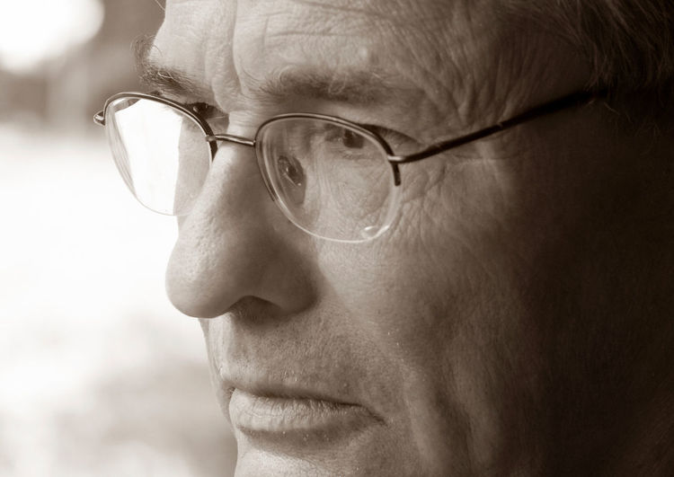 Close-Up Of Thoughtful Mature Man Wearing Eyeglasses