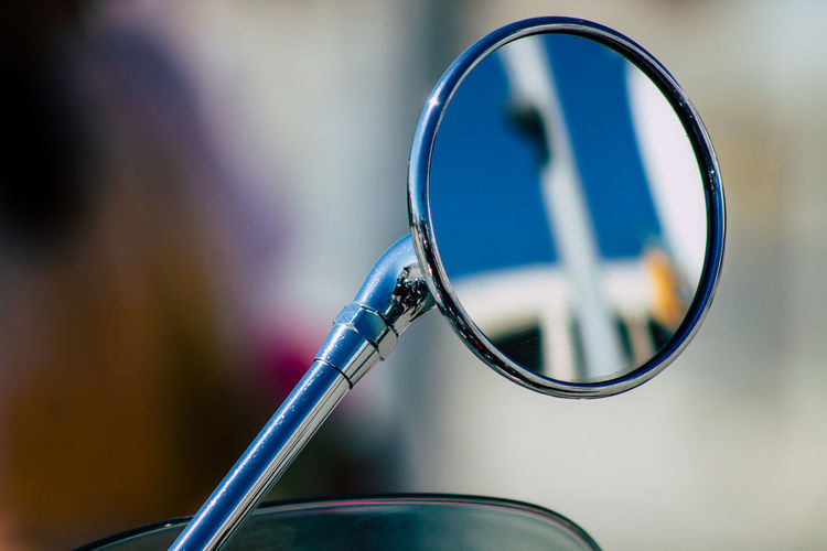 Close-up of motorcycle mirror