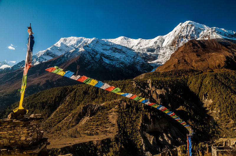 Scenic view of snowcapped mountains against clear sky in annapurna circuit in nepal