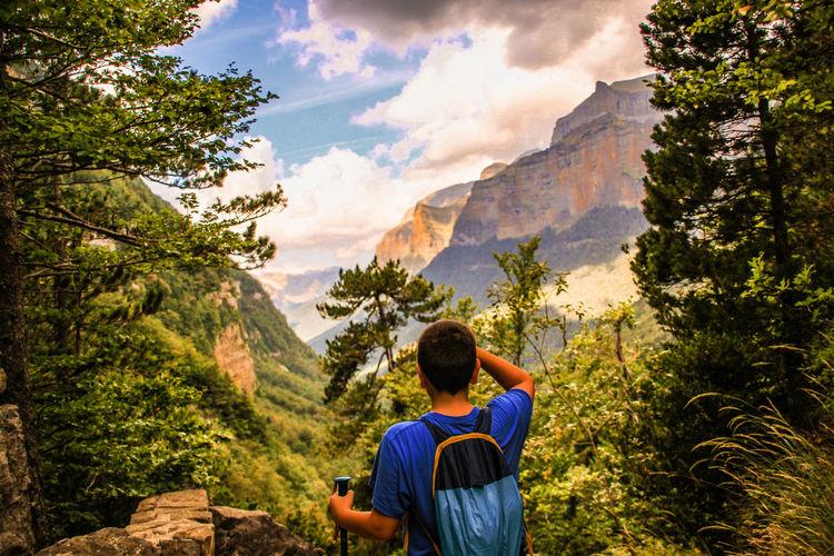 Rear view of teenager hiking at ordesa y monte perdido national park