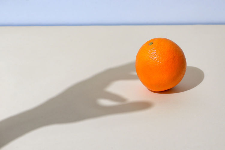 Orange fruit on table