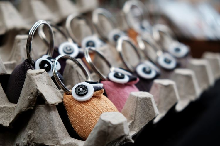 Close-up of key rings for sale in store