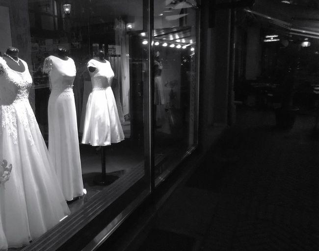People in illuminated store