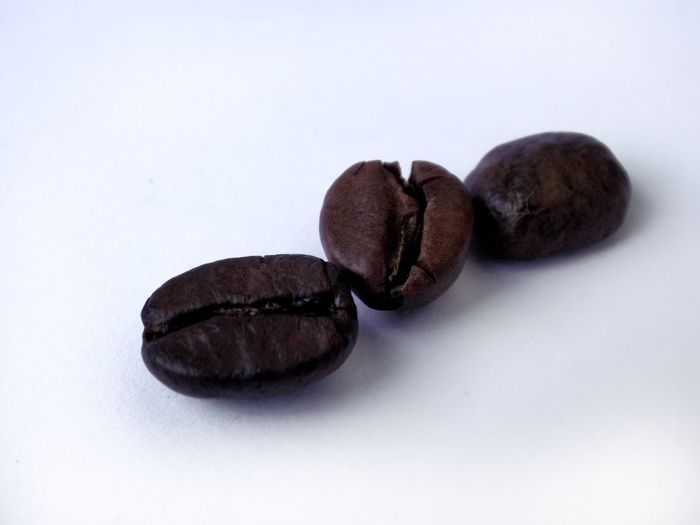 Coffee Coffee - Drink Coffee Bean Coffee Beans Caffè Caffeine Beans Roasted Roasted Coffee Bean Taking Photos EyeEm Best Shots Taking Photo Taking Pictures Textured  Shape Texture Textures and Surfaces White Background Studio Shot Close-up Food And Drink