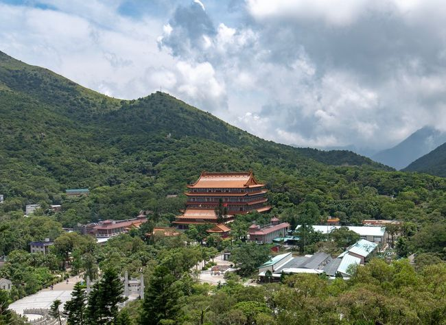 Po Lin Monestary Lan Tau Cloud - Sky Mountain Architecture Building Exterior Built Structure Building Sky Tree Plant Beauty In Nature Nature House Scenics - Nature Landscape Environment No People Green Color Residential District Mountain Range High Angle View