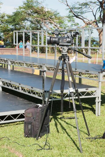 Darwin,NT,Australia-April 10,2018: Tripod setup on day of Prince Charles visit to Bicentennial Park in Darwin, Australia Australia Camera Camera - Photographic Equipment Darwin Event Filming Northern Territory Public Park Backpack Bicentennial Park Bleachers Equipment Incidental People Memorial Event News Photography Outdoors Photography Royal Still Life Television Television Camera Television Industry Tripod Video Camera Waterfront