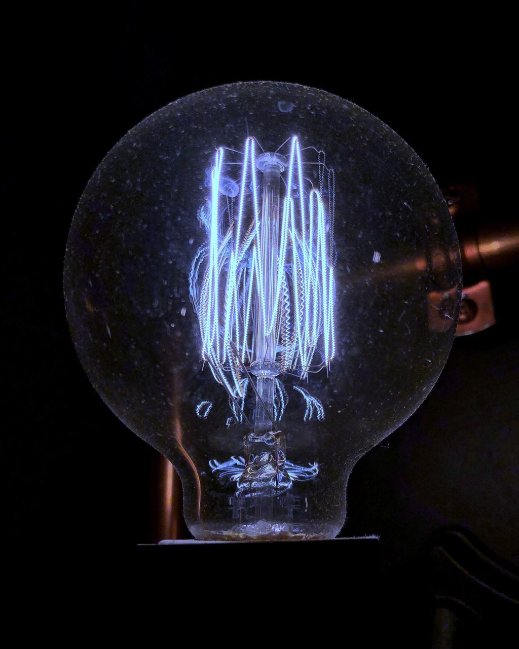 light bulb, illuminated, electricity, lighting equipment, transparent, close-up, filament, indoors, electric light, no people, black background, light, technology, glass - material, glowing, studio shot, single object, fuel and power generation, dark, light - natural phenomenon, electrical equipment, power supply, electric lamp