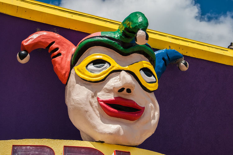 Architecture Art And Craft Built Structure Close-up Clown Craft Creativity Day Face Focus On Foreground Human Representation Low Angle View Male Likeness Multi Colored No People Outdoors Representation Sculpture Sky Statue Yellow