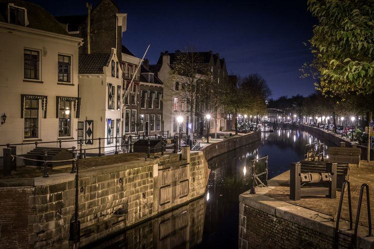 Schiedam at night Schiedam Holland Netherlands Architecture Sky Built Structure Outdoors Building Exterior Water City Canal Building Reflection No People Residential District Railing Transportation Illuminated Night Lighting Equipment Tree