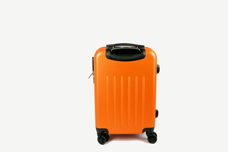 modern orange suitcase. Front view on a white background Studio Shot White Background Cut Out Copy Space Orange Color Still Life Single Object Equipment Close-up Protection Security Suitcase Luggage Luggage Trolleys Travel Vacation On The Road Front View Away Destination Handle