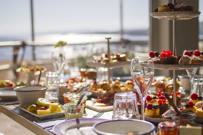 Brunch Around The World Seashore Bowl Breakfast Brunch Buffet Close-up Day Drink Drinking Glass Focus On Foreground Food Food And Drink Freshness Fruit Healthy Eating Indoors  No People Place Setting Plate Ready-to-eat Seaside Seaside Dining Table Wineglass