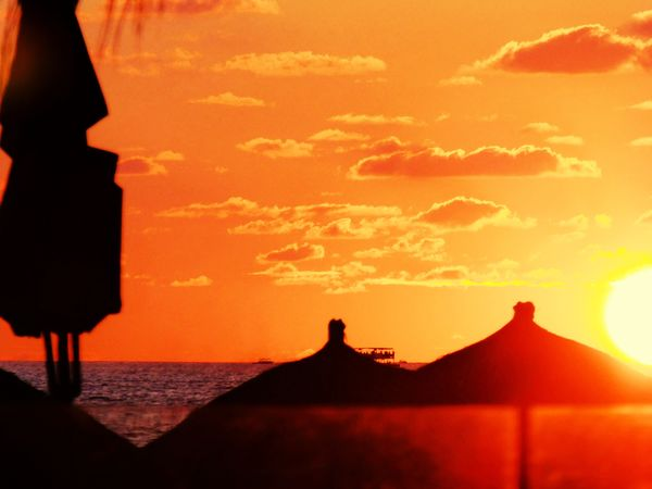 Getty Premium Collection Premium Sunset Orange Color Silhouette Sky Sea Scenics Nature Water Sun Beauty In Nature Sunlight No People Outdoors Horizon Over Water Day Selected For Premium Puerto Vallarta Puerto Vallarta, México Orange Sunset Orange Sky Beach Umbrella Palapa Sillouette Paint The Town Yellow Premium Collection