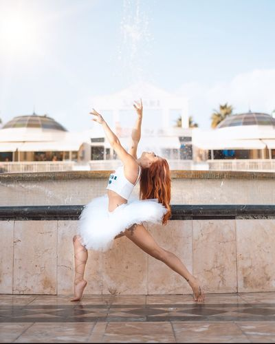 Amazing One Person Dancing Young Adult Lifestyles Architecture Full Length Young Women Built Structure Leisure Activity Real People Human Arm Arms Raised Sky Women Water Nature Building Exterior Adult Motion Outdoors EyeEmNewHere