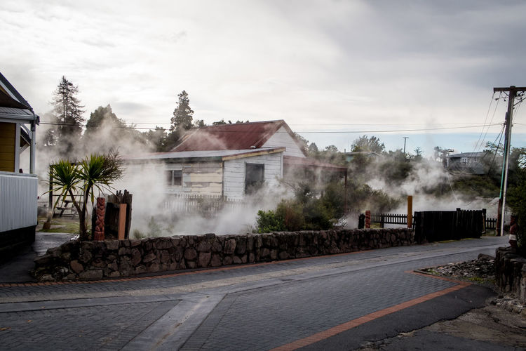 village with geothermal activity in new zealand Travel Architecture Building Building Exterior Built Structure City Cloud - Sky Day Environmental Issues Geothermal Activity House Nature New Zealand No People Outdoors Plant Residential District Road Sky Smoke - Physical Structure Traditional Transportation Tree Village The Architect - 2018 EyeEm Awards