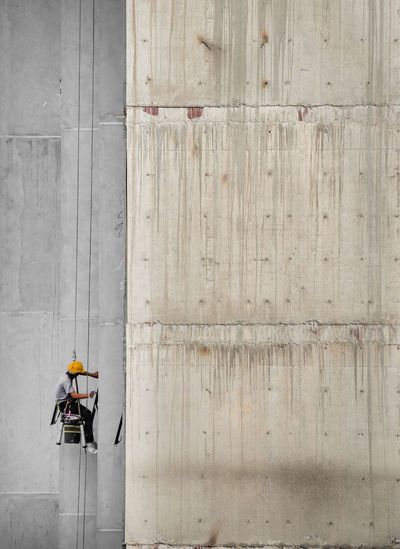 Directly above shot of worker working on wall