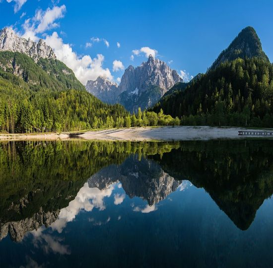 Scenic view of mountains reflecting on calm lake