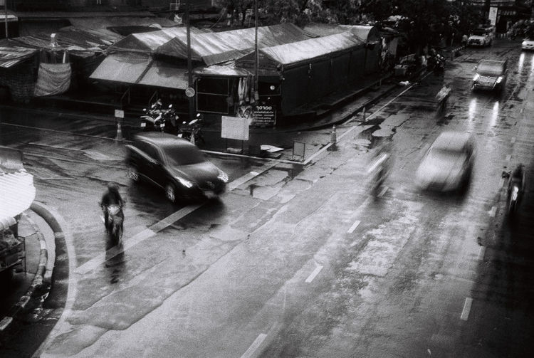 High angle view of people walking on wet road