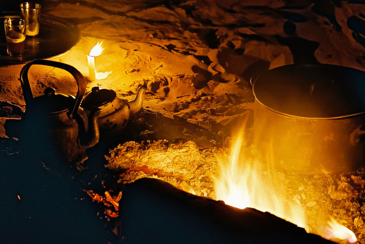 High Angle View Of Food And Drink Begin Prepared On Fire