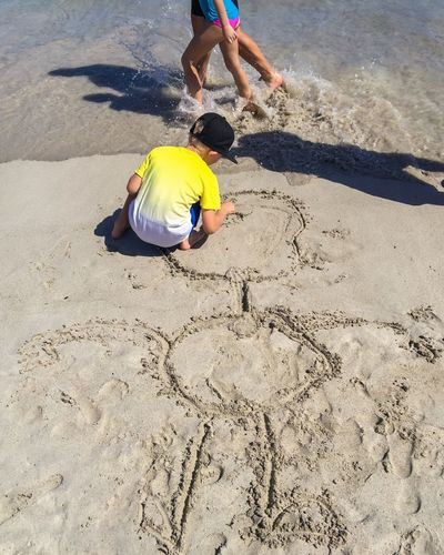 Drawing in the Sand Sea Sand Waves Western Australia Indian Ocean Beach Families Kids Childhood Childhood Memories Writing Drawing Sand Art Playing Artistic Expression Drawing In The Sand  Walking The Beach Figure Stick Figure