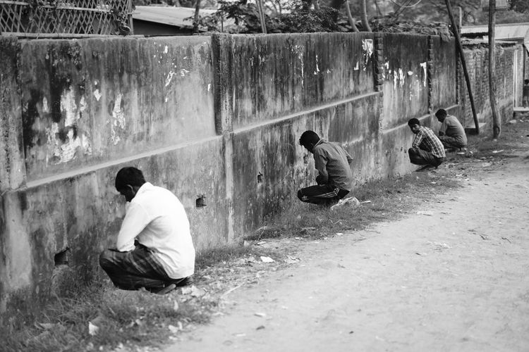 The Street Photographer - 2018 EyeEm Awards Architecture Bonding Boys Built Structure Casual Clothing Day Leisure Activity Lifestyles Males  Men Nature Outdoors People Real People Rear View Sitting Togetherness Wall - Building Feature Human Connection