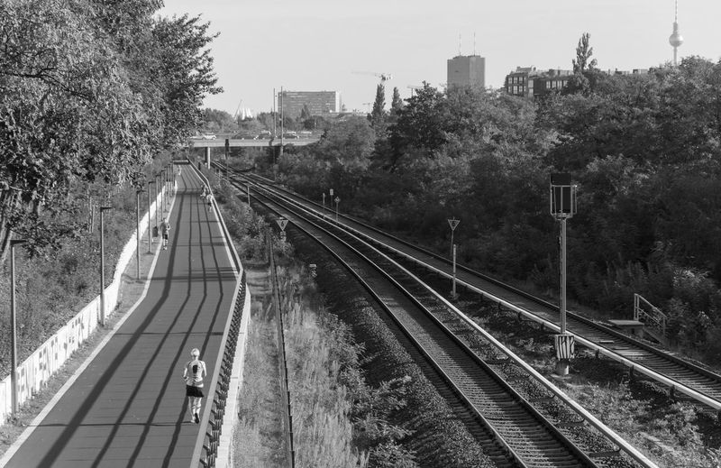 Architecture B&w Black And White City City Life Cityscape Day Jog Jogger Jogging No People Outdoors Rail Transportation Railroad Track Sky Skyline Sport Street Photography Transportation Tree Urban Exploration