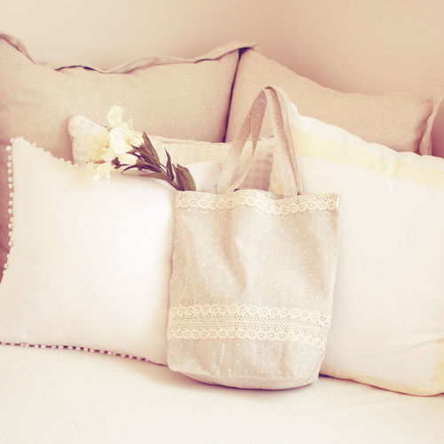 Indoors  No People Close-up Ribbon Ribbon - Sewing Item Container Furniture Still Life White Color Bed Gift Bag Pillow Bow Relaxation Paper Textile Gift Box Box Living Room Pastel Vintage Tote Bag Cute