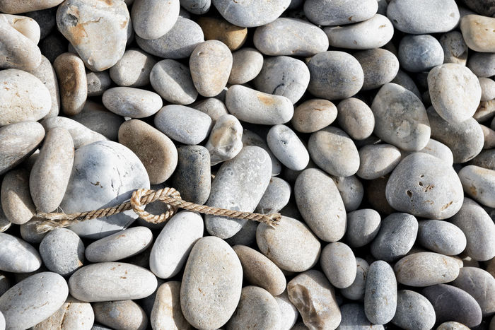 Knot EyeEm Best Shots Pebble Beach Pebbles Beach Resistance  Rope Backgrounds Beach Beauty In Nature Heart Shape Knot Nature No People Outdoors Pebble Pebbles Pebbles And Stones Pebbles On A Beach Crafted Beauty AI Now Love Yourself