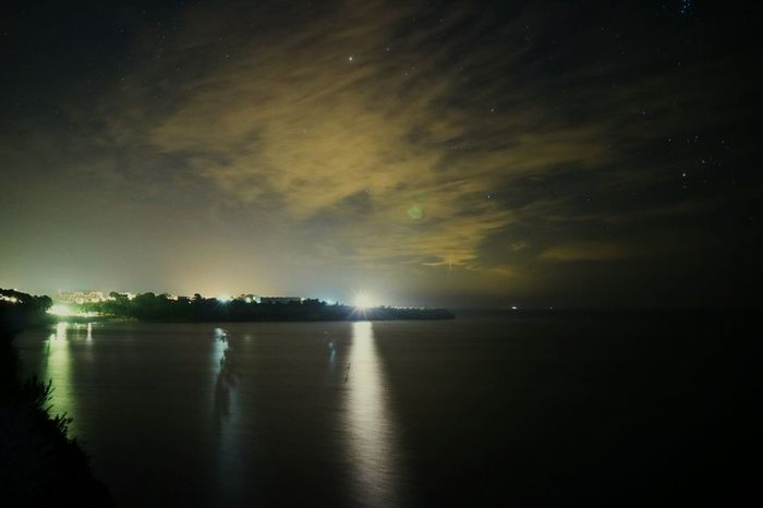 Nightphotography Night Lights Night Photography Nightlife Night View Water Reflections Waterscape Nightscape Seascape On The Seashore Eye4photography Seashore EyeEm Best Shots EyeEm Nature Lover Eyemphotography First Eyeem Photo Calm Sea Night Shadows Light And Shadow Showcase: November Learn & Shoot: After Dark The City Light HUAWEI Photo Award: After Dark