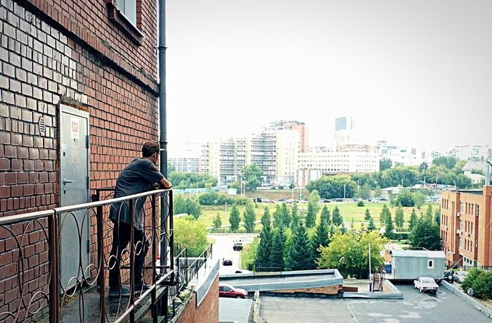Architecture Building Exterior City Built Structure Tree Clear Sky Day Sky City Life Building Story Modern Nsk Novosibirsk New Places Alone One Man Man One Smoking