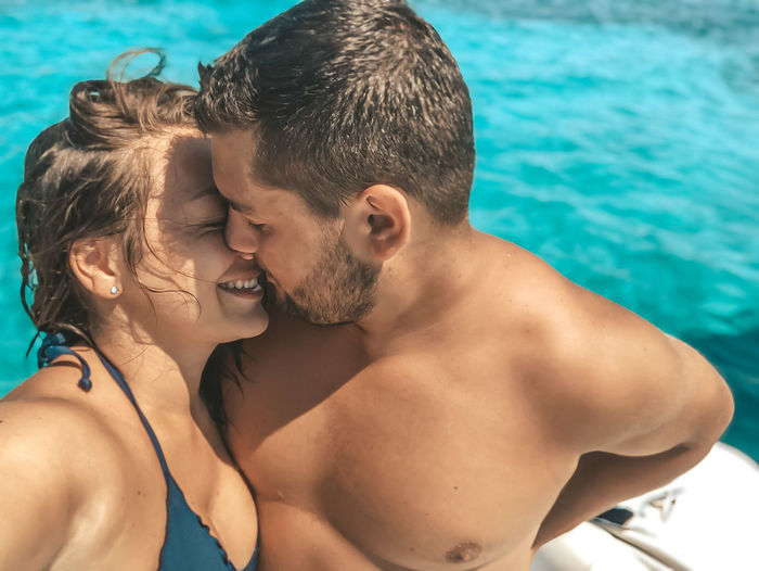 Close-up of couple romancing in swimming pool