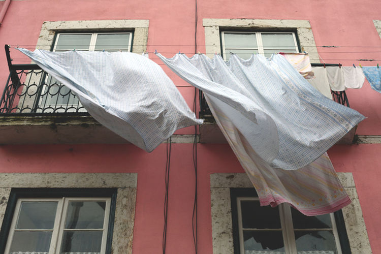 Clothes hanging in front of modern building
