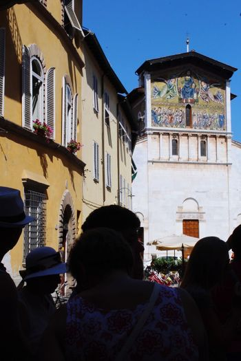 Painted Image Tourists Italy Lucca Lucca Italy Architecture_collection Architecture Built Structure Building Exterior Building Real People Group Of People Lifestyles Women Window Day Leisure Activity City Outdoors Rear View Sunlight Sky