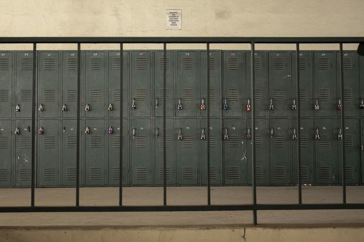 Lockers seen through railing against wall