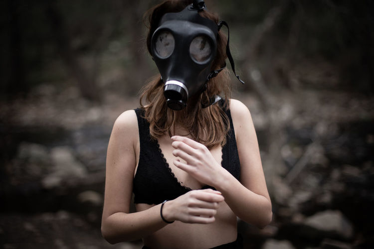 Woman wearing gas mask