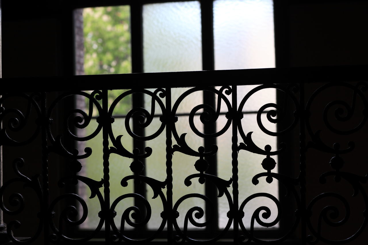 indoors, window, close-up, black color, no people, wrought iron, home interior, day, security bar