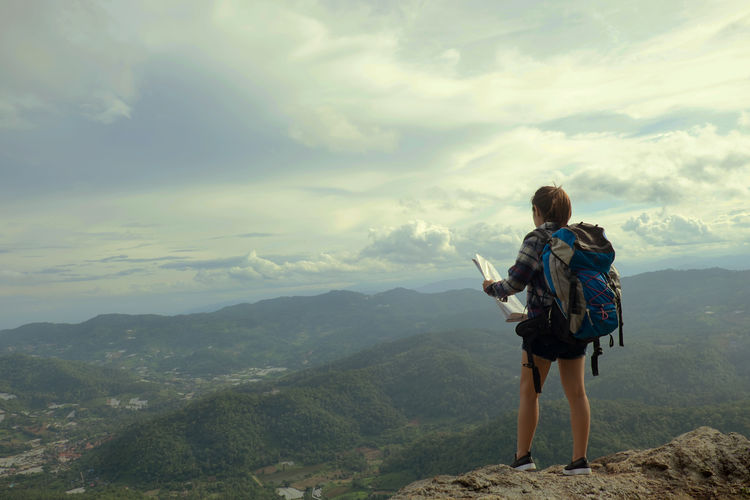woman stand on the mountain with travel and adventure concept vintage tone. Adventure Backpack Beauty In Nature Cloud - Sky Day Exploration Full Length Hiking Landscape Leisure Activity Lifestyles Men Mountain Mountain Range Nature One Person Outdoors Real People Rear View Scenics Sky Standing Travel Travel Destinations Vacations