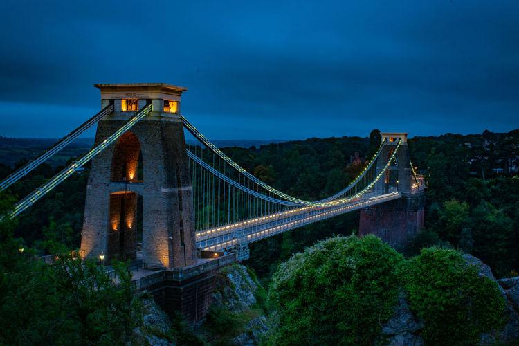 Golden gate bridge in city against cloudy sky