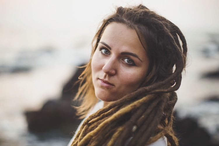 Dreadlock girl portrait on a beach background India Beach Dreadlocks Hippie EyeEm Selects Portrait Headshot One Person Looking At Camera Young Adult Young Women Women Real People Clothing Hair Adult Lifestyles Close-up Beauty Hairstyle Beautiful Woman International Women's Day 2019