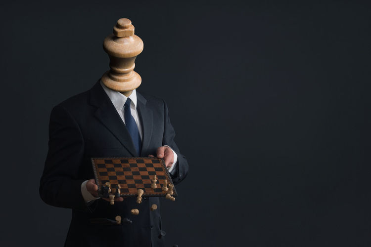 Arrogant Black Background Boss Business Businessman Chess Chess Board Chess Piece Copy Space Ego HEAD Headless Holding Job King - Chess Piece Leisure Games Men Narcism Narcissism Narcissist One Person Pawn - Chess Piece People Studio Shot Suit