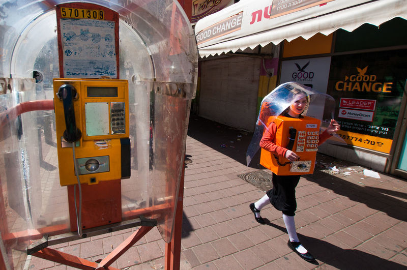 Booth Catch The Moment Catching A Show City Communication Costume Culture Israel Moment Orange Street Street Photography Streetphotography Telaviv Telephone Telephone Box Walk Walking Women