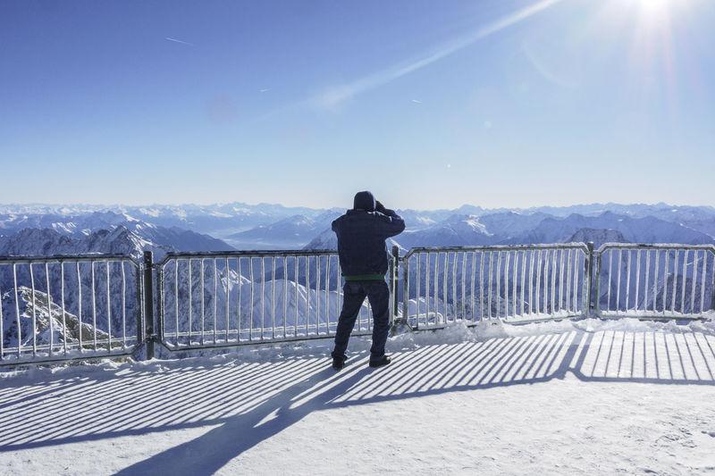 Man Overlooking Rocky Landscape