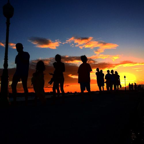 Silhouette people at sunset