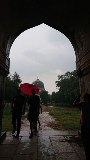 Silhouette of A Person with Pink Umbrella Rain Two People Wet Arch Adults Only Adult Full Length People Day Architecture Outdoors Tree Sky Hyderabad Monuments Qutub Shahi Tombs Sony Xperia Xz1 Sony Xperia Mobile Photography Xperian Photography Sony