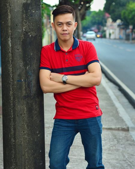 Street Photography Single Men One Person Portrait City Looking At Camera Front View Standing Confidence  Transportation Young Adult Serious Casual Clothing Adult Architecture Red Attitude Outdoors Young Men Street Arms Crossed Jeans