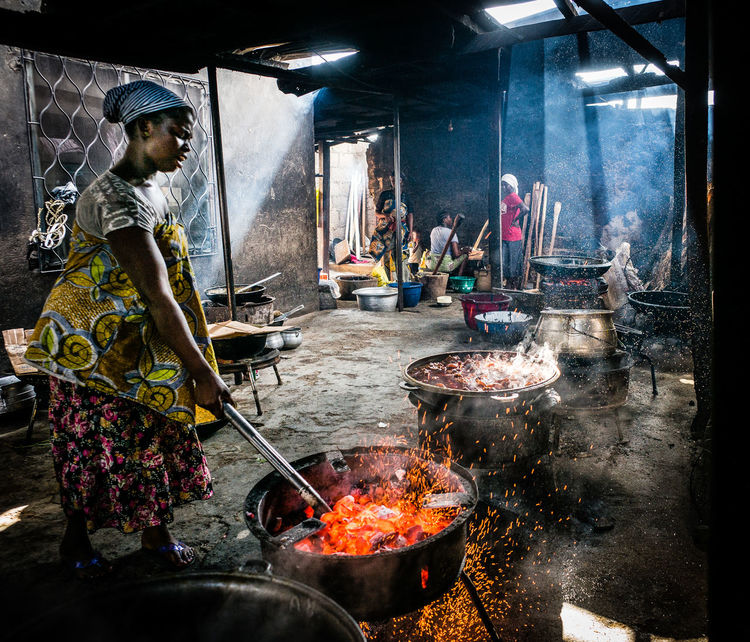 African Cooking Cooking Sweaty The Week on EyeEm African Kitchen Burning Fireplace Flame Hard Labour Heat Heat - Temperature Household Equipment Kitchen Utensil Open Fire Open Fire Cooking Preparation  Preparing Food Standing