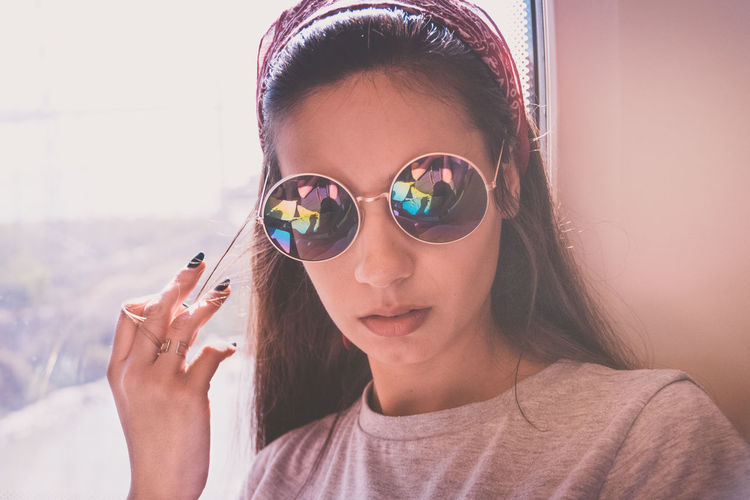 woman in the train with cool glasses Childhood Close-up Day Front View Headshot Indoors  Leisure Activity Lifestyles One Person Portrait Real People Sunglasses Young Adult Young Women